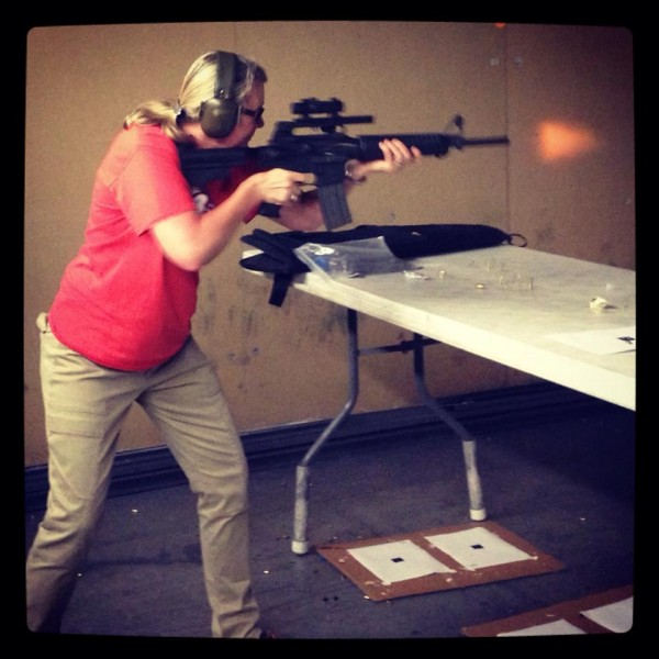 An action shot of Therese firing the AR15